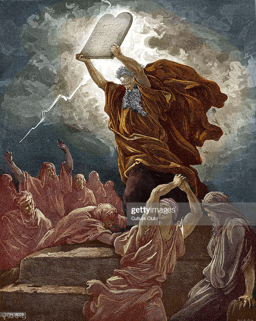 Moses breaks the tablets of the law after coming down from Mount Sinai and finding the children of Israel worshipping the golden calf: 'Moses ' anger waxed hot, and he cast the tables out of his hands, and brake them beneath the mount.' (Exodus 32 : 19 - 20). Drawn by Gustave Doré, French artist, b January 6, 1832 – January 23, 1883. Engraved by Hotelin.