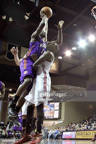 Moses Ehambe from the Iowa Energy takes the ball to the basket against DeAndre Liggins from the Sioux Falls Skyforce in their NBA DLeague game...