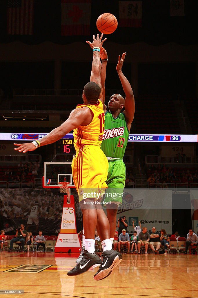 Moses Ehambe #17 of the Iowa Energy fires off a jump shot over Terrance Thomas #15 of the Canton Charge in an NBA D-League game on March 16, 2012 at the Wells Fargo Arena in Des Moines, Iowa.