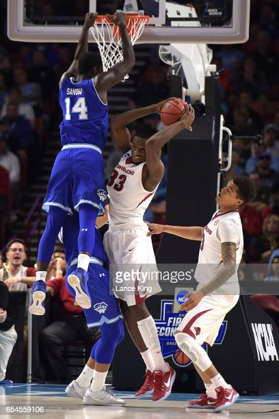 Moses Kingsley of the Arkansas Razorbacks gets a defensive rebound against Ismael Sanogo of the Seton Hall Pirates during the first round of the 2017...