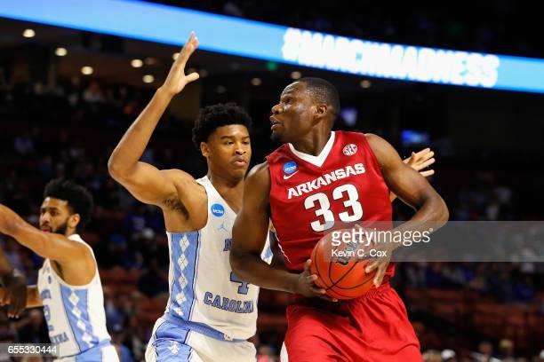 Moses Kingsley of the Arkansas Razorbacks handles the ball against Isaiah Hicks of the North Carolina Tar Heels in the first half during the second...