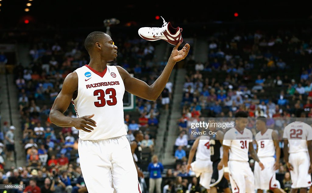 Moses Kingsley of the Arkansas Razorbacks looses his shoe against the Wofford Terriers during the second round of the 2015 NCAA Men's Basketball...