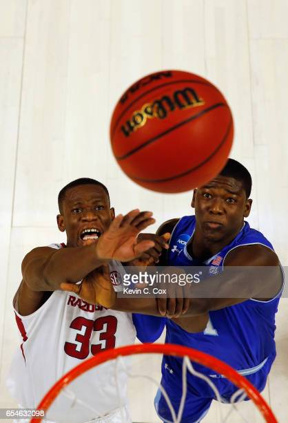Moses Kingsley of the Arkansas Razorbacks rebounds against Angel Delgado of the Seton Hall Pirates during the first round of the 2017 NCAA Men's...