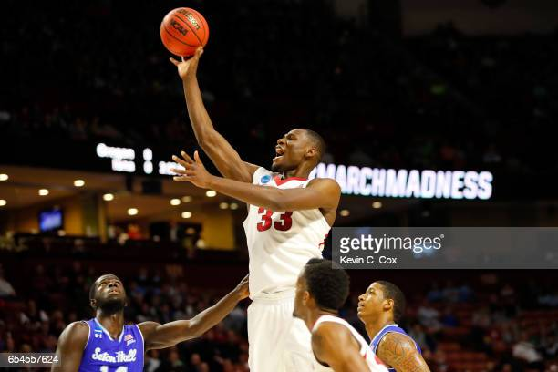 Moses Kingsley of the Arkansas Razorbacks shoots in the lane over Ismael Sanogo of the Seton Hall Pirates in the first round of the 2017 NCAA Men's...