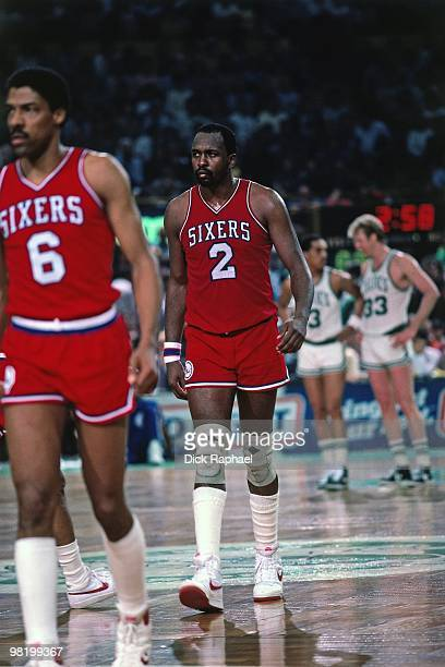 Moses Malone and Julius Erving of the Philadelphia 76ers on the court against the Boston Celtics during a game played in 1985 at the Boston Garden in...