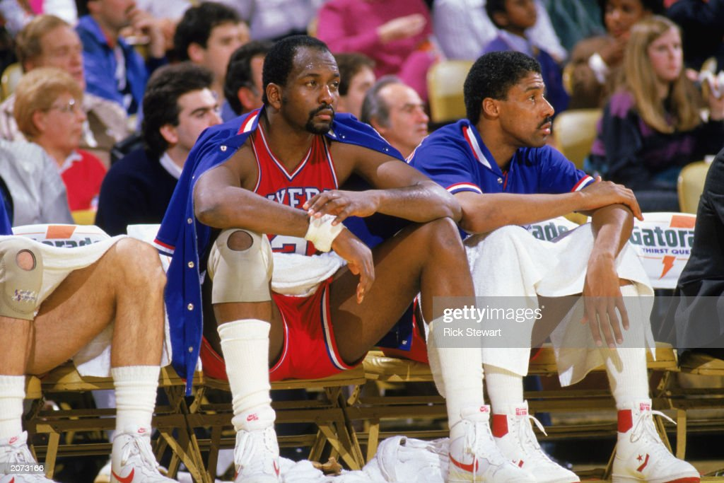 <a gi-track='captionPersonalityLinkClicked' href=/galleries/search?phrase=Moses+Malone&family=editorial&specificpeople=213188 ng-click='$event.stopPropagation()'>Moses Malone</a> #2 (left) and Julius Erving #6 of the Philadelphia 76ers sit on the bench during the 1985-1986 NBA season.