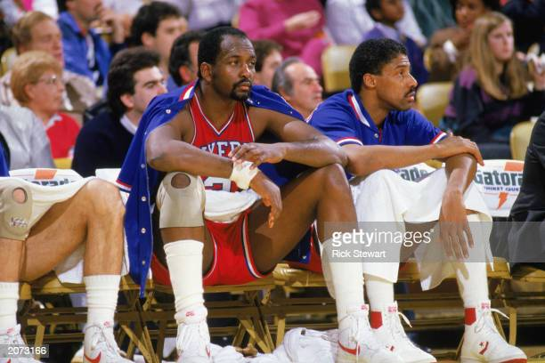 Moses Malone and Julius Erving of the Philadelphia 76ers sit on the bench during the 19851986 NBA season