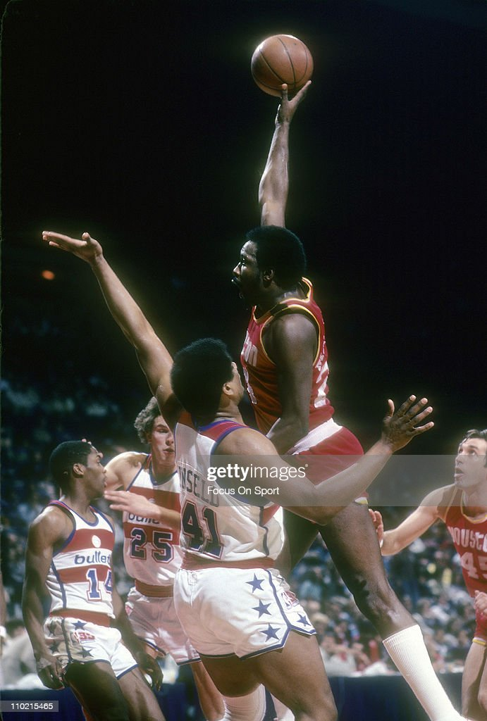 <a gi-track='captionPersonalityLinkClicked' href=/galleries/search?phrase=Moses+Malone&family=editorial&specificpeople=213188 ng-click='$event.stopPropagation()'>Moses Malone</a> #24 of the Houston Rockets shoots over <a gi-track='captionPersonalityLinkClicked' href=/galleries/search?phrase=Wes+Unseld&family=editorial&specificpeople=212864 ng-click='$event.stopPropagation()'>Wes Unseld</a> #41 of the Washington Bullets during an NBA basketball game circa 1977 at the Baltimore Civic Center in Baltimore, Maryland. Malone played for the Rockets from 1976-82.