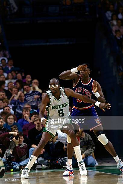 Moses Malone of the Milwaukee Bucks battles for position with Patrick Ewing of the New York Knicks during an NBA game in Milwaukee Wisconsin NOTE TO...