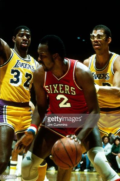 Moses Malone of the Philadelphia 76ers dribbles against Magic Johnson and Kareem AbdulJabbar of the Los Angeles Lakers during the 1983 NBA Finals at...