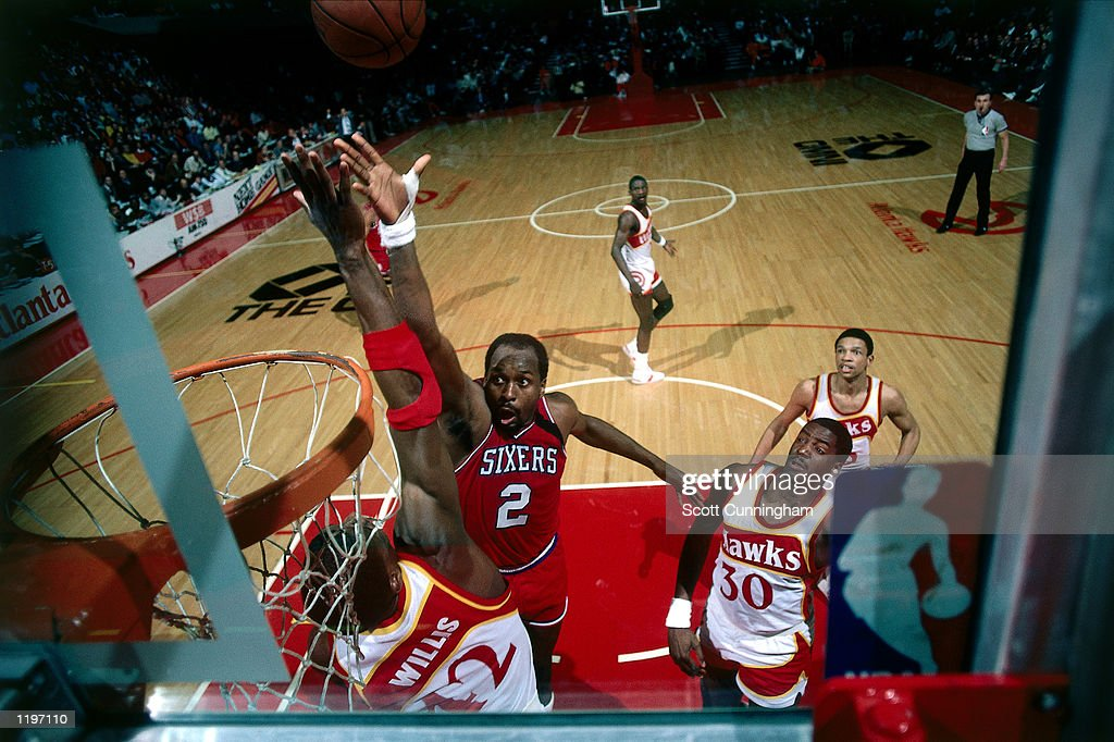 <a gi-track='captionPersonalityLinkClicked' href=/galleries/search?phrase=Moses+Malone&family=editorial&specificpeople=213188 ng-click='$event.stopPropagation()'>Moses Malone</a> #2 of the Philadelphia 76'ers drives to the basket for a layup against the Atlanta Hawks during the NBA game in Atlanta, Georgia.