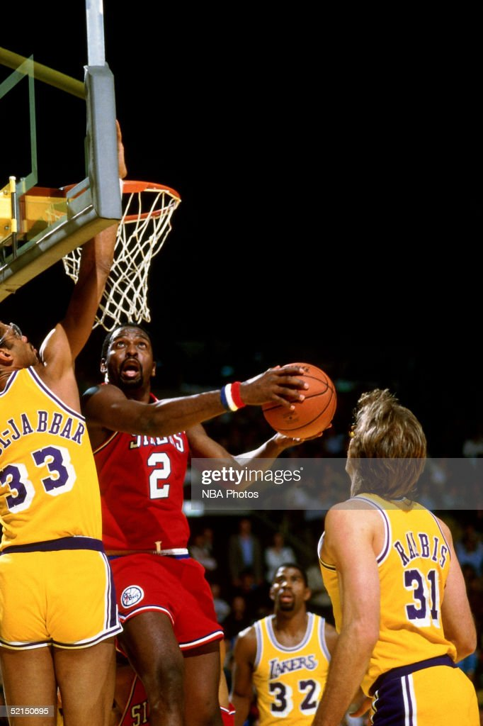 <a gi-track='captionPersonalityLinkClicked' href=/galleries/search?phrase=Moses+Malone&family=editorial&specificpeople=213188 ng-click='$event.stopPropagation()'>Moses Malone</a> #2 of the Philadelphia 76ers drives to the basket for a reverse layup against the Kareem Abdul-Jabbar #33 of the Los Angeles Lakers during an NBA game in 1982 at the Great Western Forum in Inglewood, California.