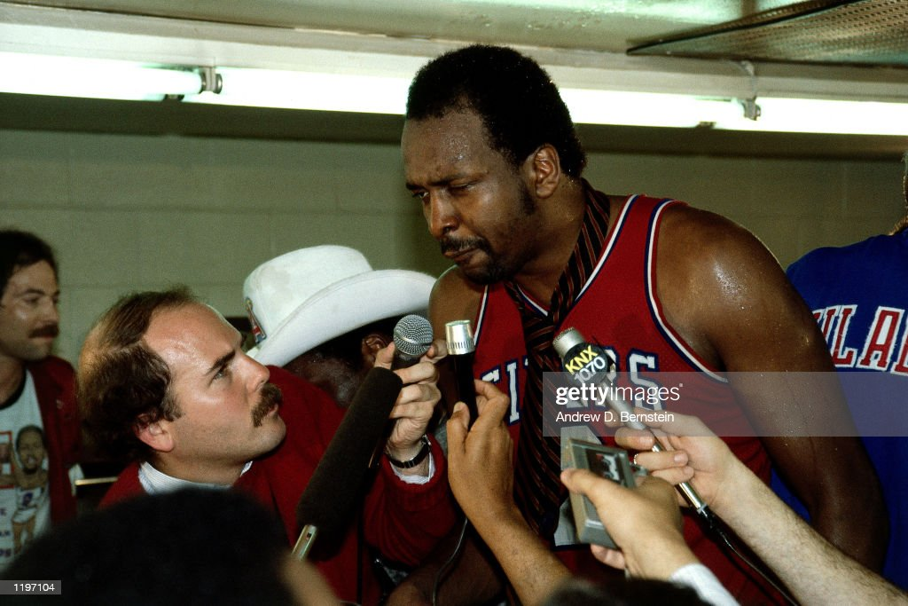 <a gi-track='captionPersonalityLinkClicked' href=/galleries/search?phrase=Moses+Malone&family=editorial&specificpeople=213188 ng-click='$event.stopPropagation()'>Moses Malone</a> #2 of the Philadelphia 76'ers gets interviewed by the media after winning the 1983 NBA Championship against the Los Angeles Lakers at the Forum in Los Angleles, California.