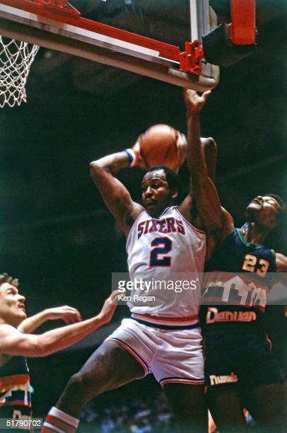 Moses Malone of the Philadelphia 76'ers grabs a rebound against the Denver Nuggets during the NBA game in Philadelphia Pennsylvania NOTE TO USER User...