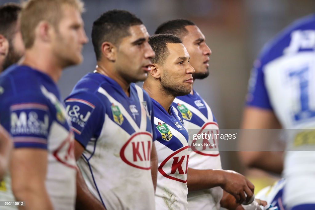 Moses Mbye of the Bulldogs and his team look dejected after a Panthers try during the round 13 NRL match between the Canterbury Bulldogs and the Penrith Panthers at ANZ Stadium on June 4, 2017 in Sydney, Australia.