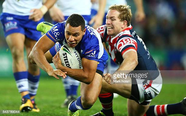 Moses Mbye of the Bulldogs is tackled during the round 17 NRL match between the Sydney Roosters and the Canterbury Bulldogs at Allianz Stadium on...