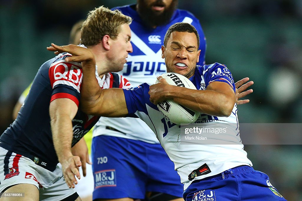 Moses Mbye of the Bulldogs is tackled during the round 17 NRL match between the Sydney Roosters and the Canterbury Bulldogs at Allianz Stadium on June 30, 2016 in Sydney, Australia.