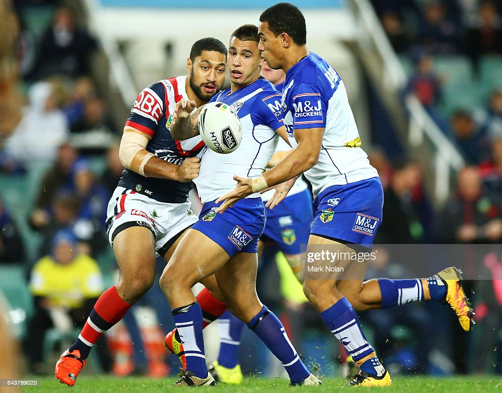 Moses Mbye of the Bulldogs offloads during the round 17 NRL match between the Sydney Roosters and the Canterbury Bulldogs at Allianz Stadium on June 30, 2016 in Sydney, Australia.