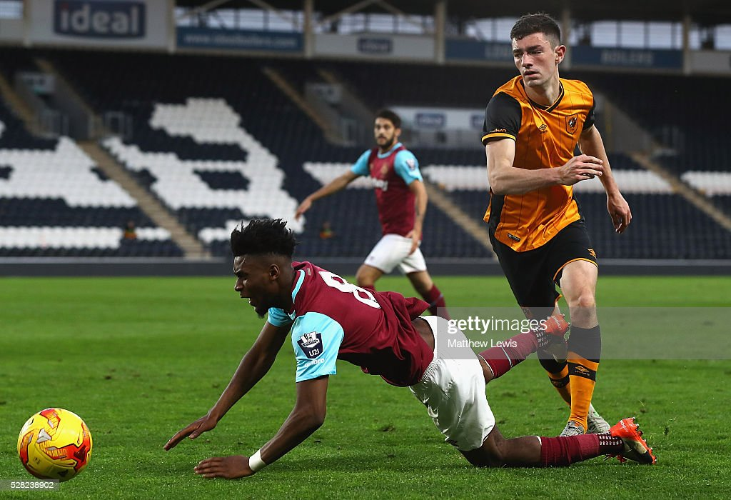 Moses Mokasi of West Ham is tackled by Brian Lenihan of Hull City during the Second Leg of the Premier League U21 Cup Final at the KC Stadium on May 04, 2016 in Hull, England.