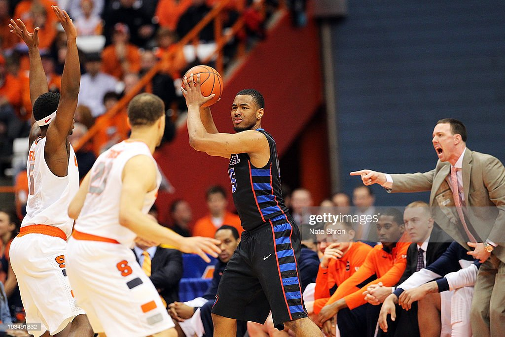 Moses Morgan #15 of the DePaul Blue Demons holds the ball as he prepares to pass against <a gi-track='captionPersonalityLinkClicked' href=/galleries/search?phrase=C.J.+Fair&family=editorial&specificpeople=7366451 ng-click='$event.stopPropagation()'>C.J. Fair</a> #5 and <a gi-track='captionPersonalityLinkClicked' href=/galleries/search?phrase=Brandon+Triche&family=editorial&specificpeople=6516120 ng-click='$event.stopPropagation()'>Brandon Triche</a> #20 of the Syracuse Orange as assistant coach <a gi-track='captionPersonalityLinkClicked' href=/galleries/search?phrase=Gerry+McNamara&family=editorial&specificpeople=207001 ng-click='$event.stopPropagation()'>Gerry McNamara</a> reacts from the bench during the game at the Carrier Dome on March 6, 2013 in Syracuse, New York.