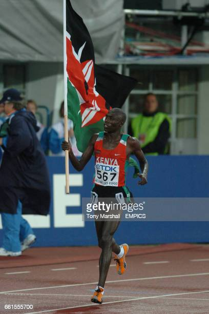 Moses Mosop of Kenya celebrates with his national flag after the mens 10000m final