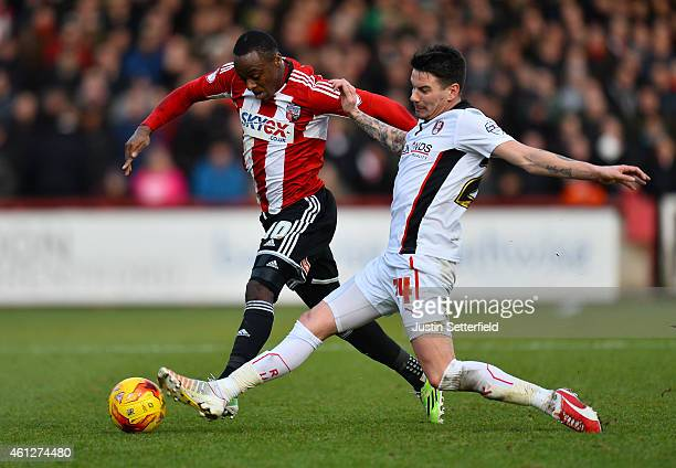 Moses Odubajo of Brentford FC and Adam Hammill of Rotherham in action during the Sky Bet Championship match between Brentford and Rotherham United at...