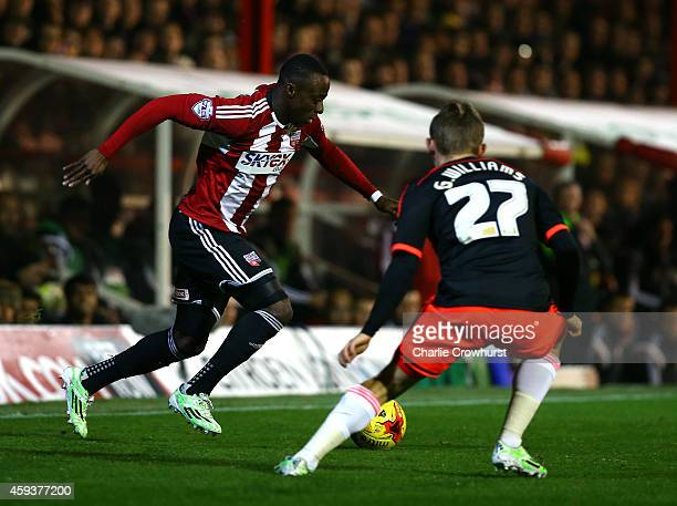 Moses Odubajo of Brentford looks to attack past George Williams of Fulham during the Sky Bet Championship match between Brentford and Fulham at...