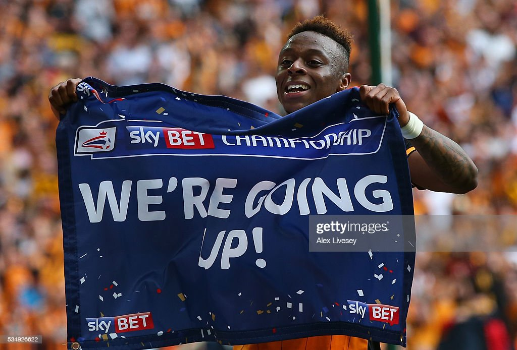 <a gi-track='captionPersonalityLinkClicked' href=/galleries/search?phrase=Moses+Odubajo&family=editorial&specificpeople=9973019 ng-click='$event.stopPropagation()'>Moses Odubajo</a> of Hull City celebrates his team's win and promotion to the Premier League after Sky Bet Championship Play Off Final match between Hull City and Sheffield Wednesday at Wembley Stadium on May 28, 2016 in London, England.