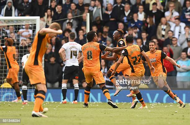 Moses Odubajo of Hull City celebrates with team mates as Jason Shackell of Derby County scores an own goal for their second during the Sky Bet...