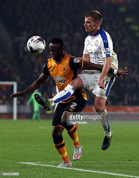 Moses Odubajo of Hull City challenged by Marc Albrighton of Leicester City during the Capital One Cup Fourth Round match between Hull City and...