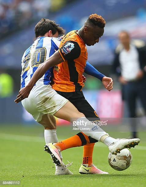 Moses Odubajo of Hull City controls the ball under pressure of Kieran Lee of Sheffield Wednesday during Sky Bet Championship Play Off Final match...