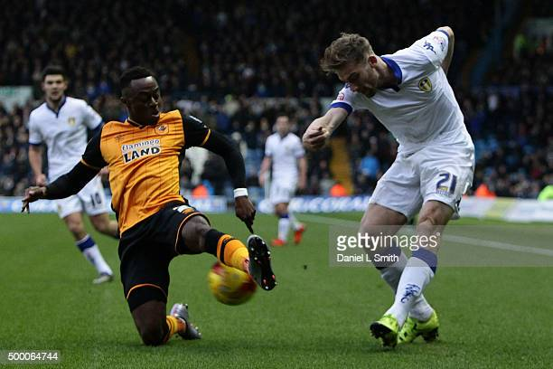 Moses Odubajo of Hull City FC smothers a pass from Charlie Taylor of Leeds United FC during the Sky Bet Championship League match between Leeds...