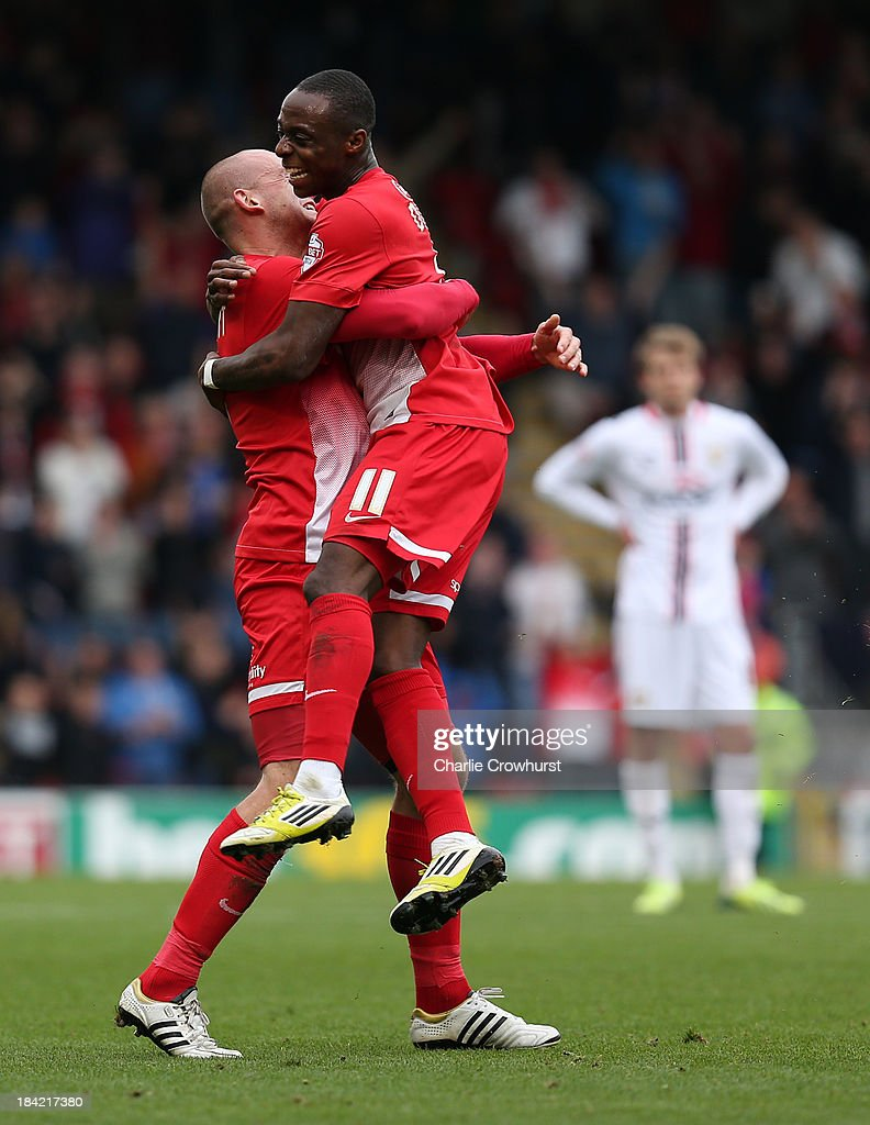 Moses Odubajo of Leyton Orient celebrates with team mate Scott Cuthbert after scoring the first goal of the game during the Sky Bet League Once match between Leyton Leyton Orient and MK Dons at The Matchroom Stadium on October 12, 2013 in London, England.