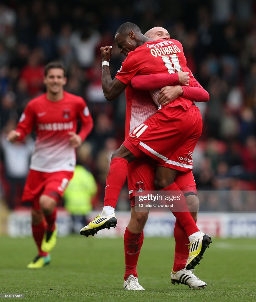 Moses Odubajo of Leyton Orient celebrates with team mate Scott Cuthbert after scoring the first goal of the game during the Sky Bet League Once match between Leyton Orient and MK Dons at The Matchroom Stadium on October 12, 2013 in London, England.