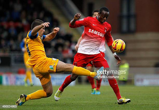 Moses Odubajo of Leyton Orient competes with John Welsh of Preston during the Sky Bet League One match between Leyton Orient and Preston North End at...
