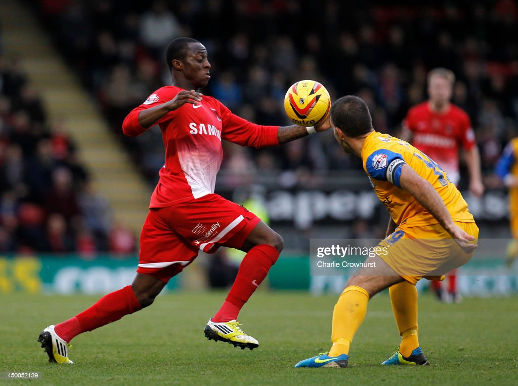 Moses Odubajo of Leyton Orient (L) looks to get round John Welsh of Preston during the Sky Bet League One match between Leyton Orient and Preston North End at The Matchroom Stadium on November 16, 2013 in London, England.