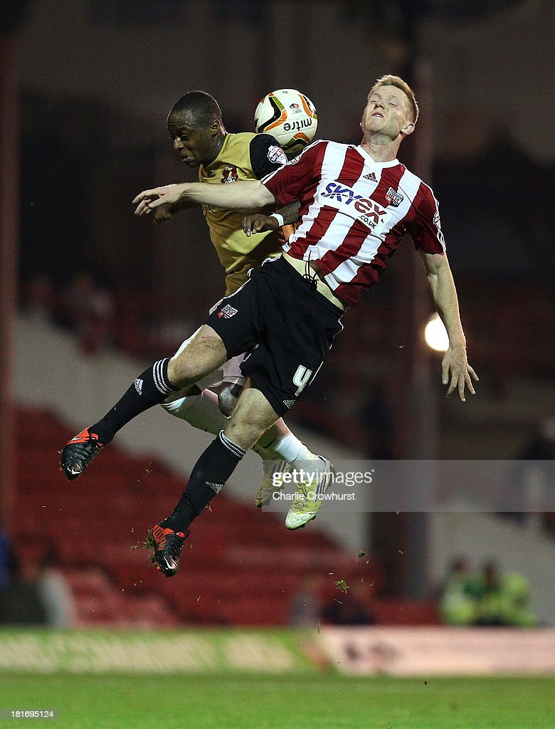 Moses Odubajo of Orient challenges Adam Forshaw of Brentford for the ball during the Sky Bet League Once match between Brentford and Leyton Orient at Griffin Park on September 23, 2013 in Brentford, England.