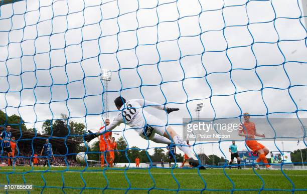 Moses Ogbu of IK Sirius FK scores the decisive goal to 10 during the Allsvenskan match between IK Sirius FK and Athletic FC Eskilstuna at...