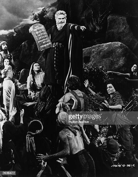 Moses played by Charlton Heston descends from Mount Sinai carrying the ten commandments to berate the worshippers of the golden calf in the remake of...