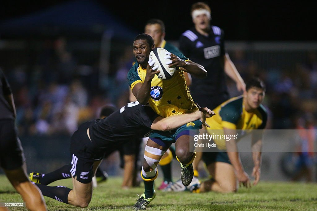 Moses Sorovi of Australia runs the ball during the Under 20s Oceania Rugby match between Australia and New Zealand at Bond University on May 3, 2016 in Gold Coast, Australia.