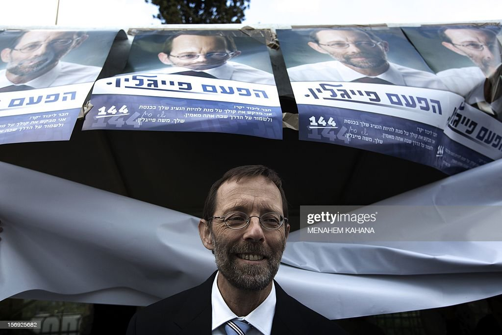 Moshe Feiglin, ruling rightwing Likud party candidate, leaves a polling station after casting his vote on November 25, 2012 in Jerusalem, in his party's leadership primary ahead of a general election on January 22. According to army radio, Prime minister Netanyahu has been putting pressure on his supporters to work to block any candidates seen as too extreme so that he will be able to present a 'moderate' list which will not alienate centrist voters. AFP PHOTO / MENAHEM KAHANA