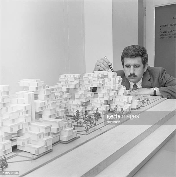 Moshe Safdie an architecture student at McGill University in Montreal Quebec examines a mockup of Habitat 67 The giant 13story apartment complex...