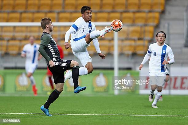 Moshtagh Yaghoubi of Finland is challenged by Timo Werner of Germany during the 2017 UEFA European U21 Championships Qualifier between U21 Germany...