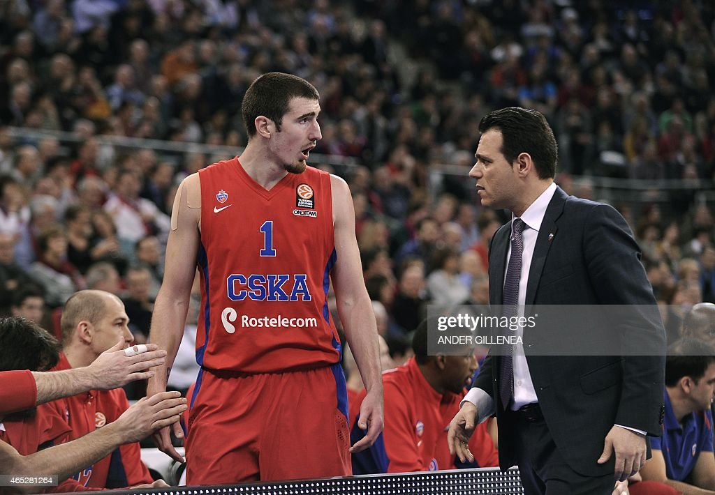 Moskow's French guard Nando De Colo speaks with CSKA Moscow's coach Dimitris Itoudis during the Euroleague Top 16 round 9 basketball match Laboral...
