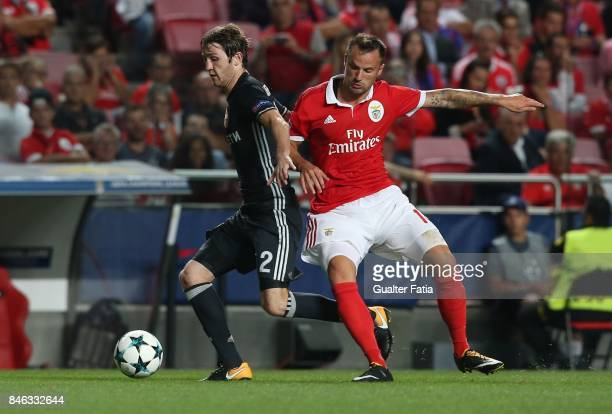 Moskva defender Mario Fernandes from Russia with SL Benfica forward Haris Seferovic from Switzerland in action during the UEFA Champions League match...