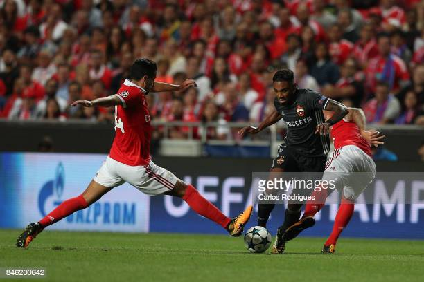 Moskva«s forward Vitinho from Brazil tries to escape Benfica's defender Andre Almeida from Portugal and Benfica's forward Haris Seferovic from...