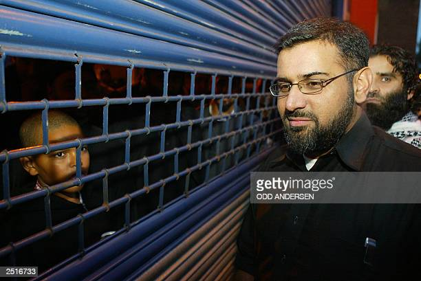 Moslem devotees watch Anjem Choudary leader of the radical Islamic group alMuhajiroun being locked out of 788 Tottenham High road in north London 11...