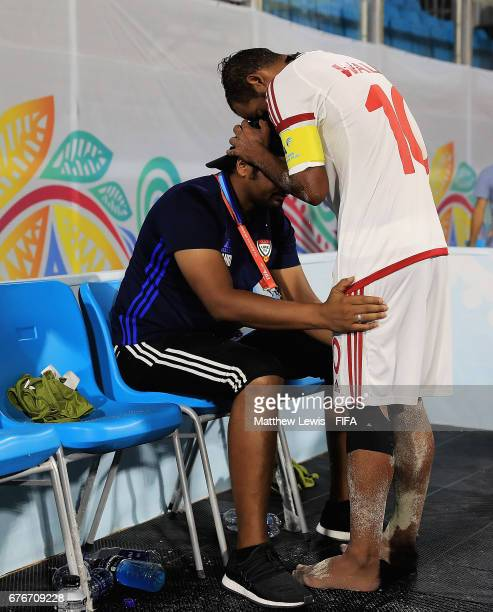 Moslem Mesigar captain of Iranconsoles Head coach / Manager of Iran Mohammad Mirshamsi after they team lost to Portugal during the FIFA Beach Soccer...