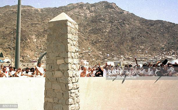 Moslem pilgrims throw stones 07 April at a pillar representing the devil who tried to tempt the prophet in Mecca More than 17 million Moslems have...