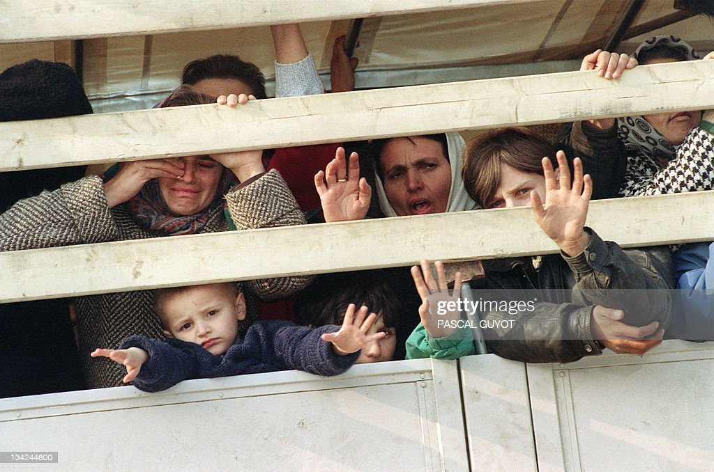 Moslem refugees ride a United Nations truck in a UN convoy as they flee the Serbbesieged Bosnian enclave of Srebrenica for Tuzla 31 March 1993 More...